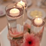 Lit candles at wedding reception