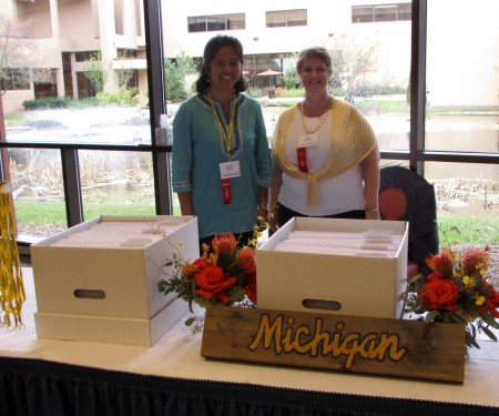 Photo of table in lobby with two women selling Michigan items