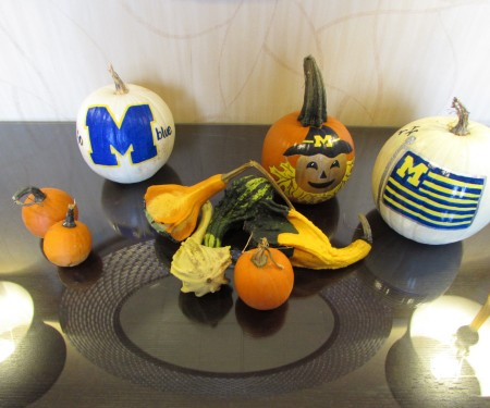 Collection of halloween and pumpkin ceramics on table display