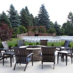 Chairs crowded around the patio firepit