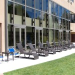 Lounge chairs right outside building waiting for the sun's rays