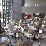 The Terrace room restaurant with plenty of set tables and oblong light