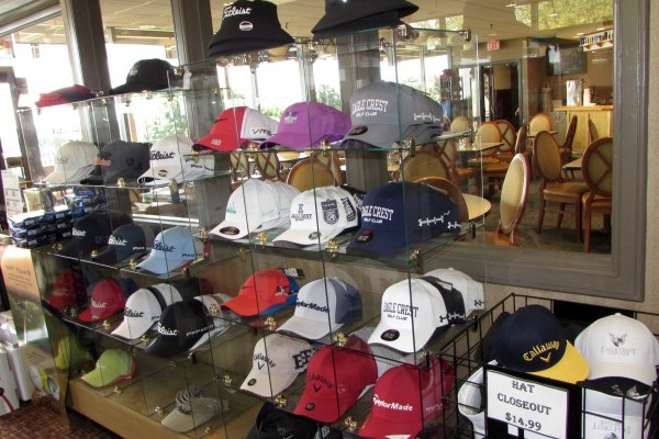 A display case with rows and columns of different hats for sale