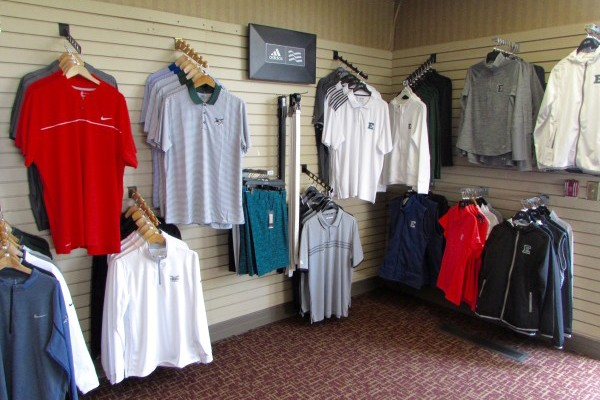Shirts neatly scattered across the golf shop walls