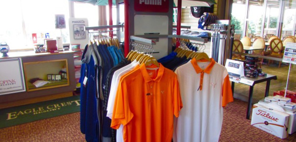 Shirts on display in the golf shop take shelter under a Eastern umbrella