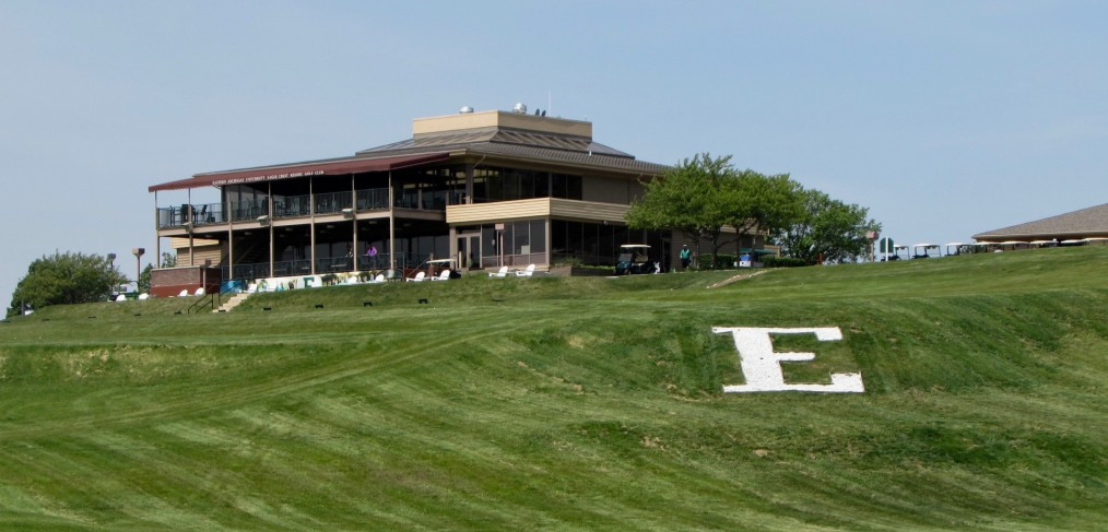 Eastern Michigan University Eagle logo adjacent to golf shop and grill of the Eagle Crest Resort Golf Club